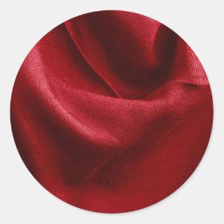 Rött vikt tyg runt klistermärke