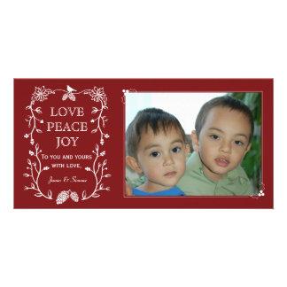 Rött vintergrönt kort för julhelgdagfoto