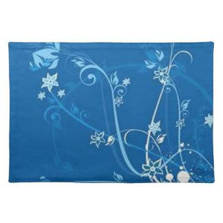 Rullor med blommor på malde blått - bordstablett