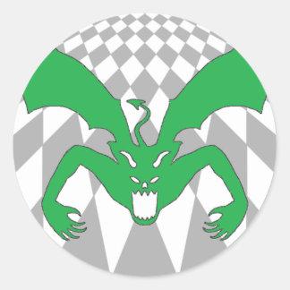 Rutig grön djävulen runt klistermärke