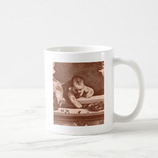 Sakralt och profant specificera förkopprar in kaffemugg