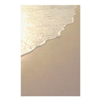 Sand på strand- och havbrevpapperet brevpapper