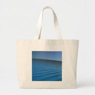 Sands för hav för naturstrandblått kassar