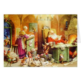 Santa & Fru Claus & älvorna kontrollerar hans Hälsningskort