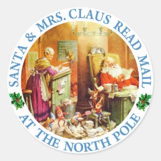 Santa & Fru Claus Framställning en lista och Runt Klistermärke