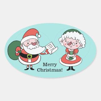 Santa & Fru Claus klistermärkear Ovalt Klistermärke