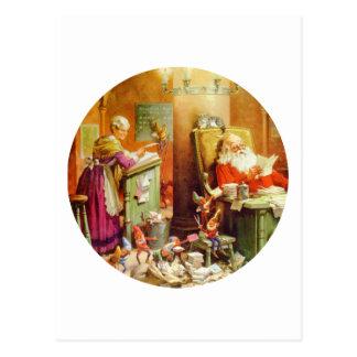 Santa & Fru Claus skapar deras för att lista av Vykort