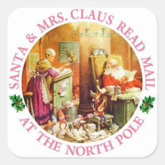 Santa och Fru Claus på nordpolenen Fyrkantigt Klistermärke