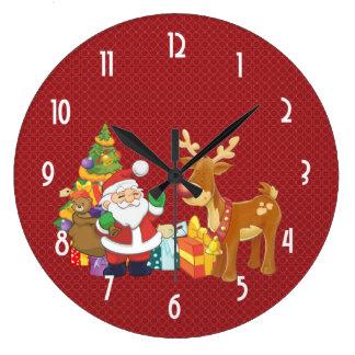 Santa och ren vid julgranen med presenter stor rund klocka