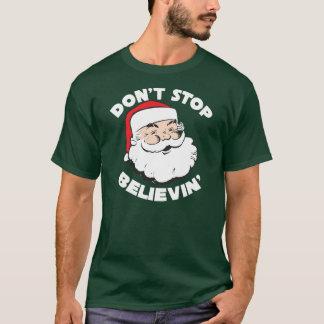 Santa stoppar inte Believin T skjortor T-shirts