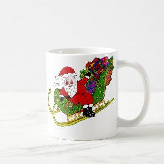 Santas bootyer och kängor på den kaffe-/Teamuggen Kaffemugg