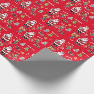 Santas leksaker och älvor som slår in pappersgrönt presentpapper