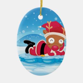 Santas ren ovanför isberget ovalformad julgransprydnad i keramik