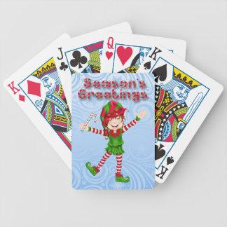 Säsong hälsningälva som leker kort spelkort