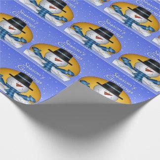 Säsong hälsningsnögubbe som slår in papper presentpapper