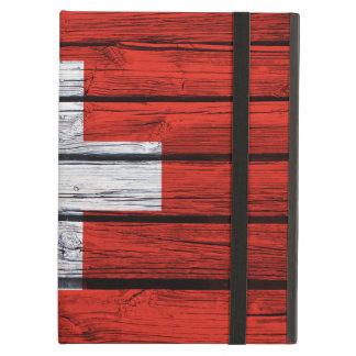 Schweizareflagga som målas på lantligt trä