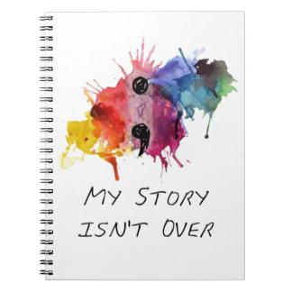 Semikolonet min berättelse är inte över anteckningsbok med spiral