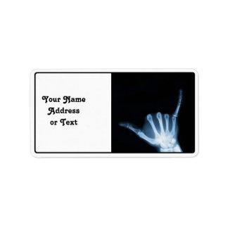 Shaka undertecknar röntgar (den lösa hängningen) adressetikett