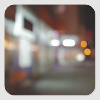 Shoppar den stads- platsen för natten med diffus fyrkantigt klistermärke