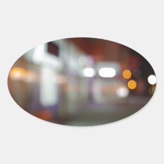 Shoppar den stads- platsen för natten med diffus ovalt klistermärke