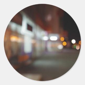 Shoppar den stads- platsen för natten med diffus runt klistermärke