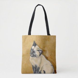 Siamese katt på guld tygkasse