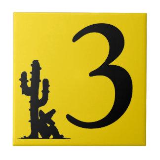 Siestaen vid kaktusgulthett numrerar 3 tre kakelplatta