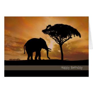Silhouetteelefant med solnedgångfödelsedagkortet hälsningskort