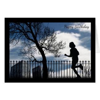 Silhouettespringer i stadsfödelsedagkortet hälsningskort