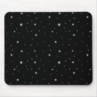 Silverstjärnor på svart musmatta