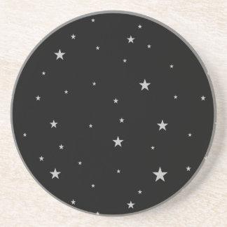 Silverstjärnor på svart underlägg sandsten