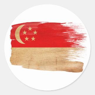 Singapore flagga runt klistermärke