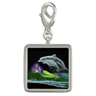 Sjöjungfru med delfiner foto berlock