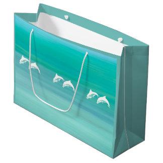 Skämtsamma och lyckliga delfiner i aquamarinehav