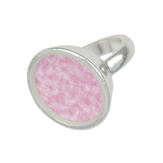 Skapad rosa- och vitmolndesign på rundaringen fotoringar