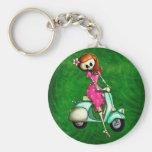 Skelett klämmer fast upp flicka på sparkcykeln nyckelringar