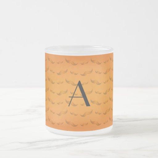 Skina orange mustaschmönster för Monogram Kaffe Mugg