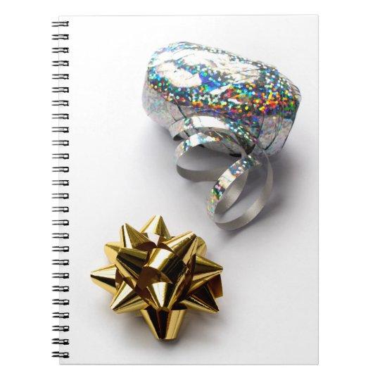 Skina pilbåge för gåvasjal och spiral anteckningsbok med spiral