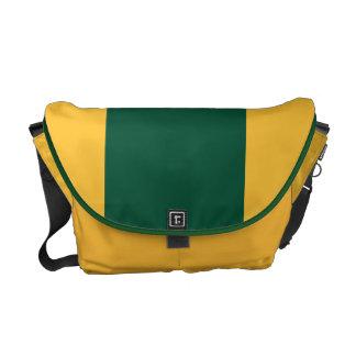 Skoggrönt och guld kurir väskor