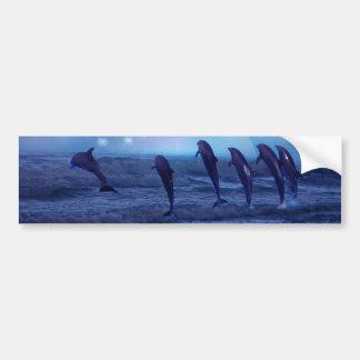 Skola av delfiner vid månsken bildekal