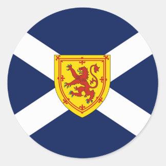 Skotsk flaggadesign runt klistermärke