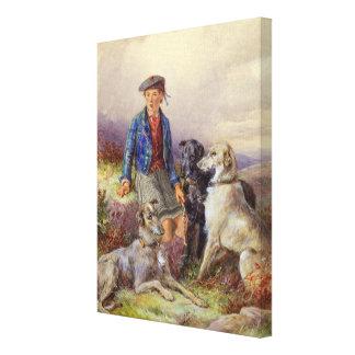 Skotsk pojke med wolfhounds i en höglands- landsca canvastryck