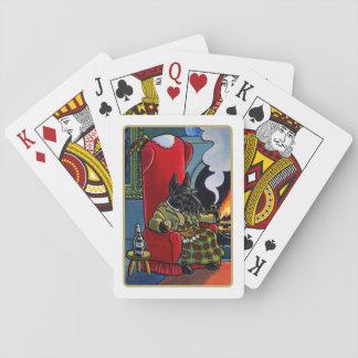Skotsk TerrierLairdhund som leker kort Spelkort