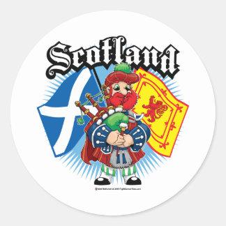 Skottland flaggor och pipblåsare runt klistermärke