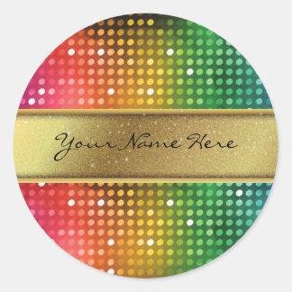Skraj diskoljus med den guld- glitternamnranden runt klistermärke