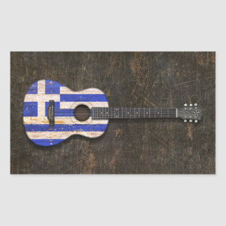 Skrapad och ha på sig akustisk gitarr för grekisk