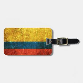 Skrapad och ha på sig colombiansk flagga för vinta luggage tag