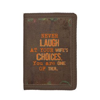 Skratta aldrig på fru den humoristiska plånboken