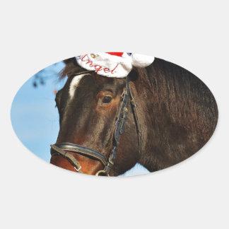 Skratta julhästen ovalt klistermärke