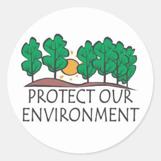 Skydda vår miljö runt klistermärke